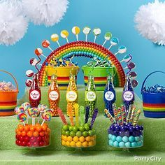 Leprechauns of all ages will love this whimsical arrangement of gumballs, rock candy and whirly pops in all the colors of the rainbow! Click to for our rainbow candy table how-to!