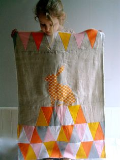 That's the Point Stroller Quilt - orange triangles