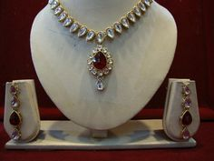 DIAMOND STRING RUBY SET -   Zircon and Ruby studded Necklace Set with Matching Earrings. Price -  $59.00. Description -  String styled zircon studded necklace set with artificial ruby pendent and a pair of matching earrings styled with an ruby drop. #Jewelry