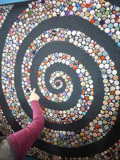 ButtonArtMuseum.com - Tokyo Quilt Festival 2013 by Saké Puppets, via Flickr.  The circles are made of kimono silks.