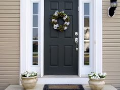 Love the black door with white trim and tan siding
