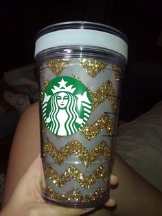 DIY glitter chevron starbucks cup! you'll need: starbucks create-your-own cold cup (mines grande size), vellum (translucent paper), clear tacky glue, gold glitter.