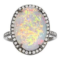 $4585 Mischa Oval Opal Ring by Lauren K.  United States  21st Century  One-of-a-Kind Mischa Ring set in 18k black gold with an oval opal (4.15cts) and white diamonds (0.29cts). Size 6 (Can be sized)