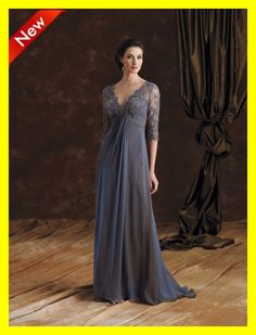 Lovely flowing grey evening gown embellished with lace. Flattering three quarter length lace sleeves.