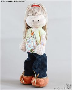 Crochet baby doll from mixed yarn. filler hollofayber Hair pin fixation of the head Arms and legs with steel wire frame. Bugle used to weight Eyes - plastic Hair - textiles, it is possible to change the hairstyle. Clothing is not removable Height 25cm