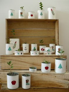 Tin cans painted white + illustrated