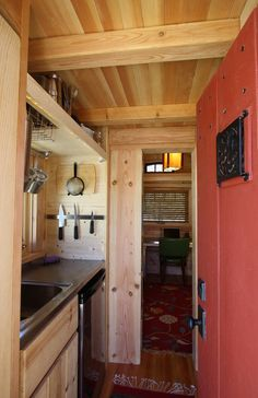 The Gifford tiny house: Great room opposite from entry, with desk along short wall.