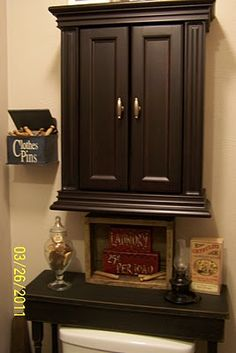 This is a really great idea, a narrow table over the toilet and painted prim black of course