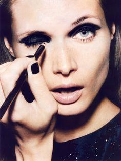smokey eyes, black nails, nude lips.