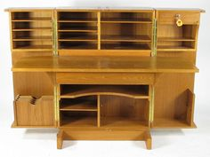 The Wooten Desk (likely designed by Leif Elvestad), photo 141, is a classic example of Danish modern design reaching back to antique designs...