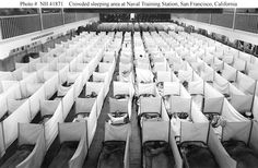 Influenza Epidemic of 1918:  During 1918's final four months an extraordinarily virulent influenza strain blazed across the Globe, killing as many as a hundred million people, six-percent of the World's population.     PHOTO:  Naval Training Station, San Francisco, California.  Crowded sleeping area extemporized on the Drill Hall floor of the Main Barracks with sneeze screens erected as a precaution against the spread of influenza.