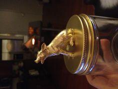 Diy animal jar. 1) Super glue animal. 2) spray paint!