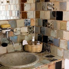 love this idea of using mis-matched tile for border or wall...