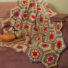 Take a look at this psychedelic Honeycomb Crochet Throw that is sure to add a pop of color to any room in your home.