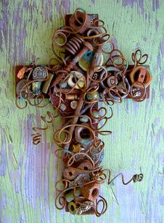 6 Inch Rustic Wall Cross Wire Wrapped with Rusty Nuts and Bolts For Your Wall. $48.50, via Etsy.