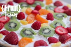 fruit pizza with sugar cookie crust, cool whip, cream cheese and fruit!