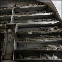 Corpses stacked on display in the Capuchin Crypt, Palermo, Sicily, Italy  I have always found different burial customs fascinating, but this and the Catacombs are really macabre to me.