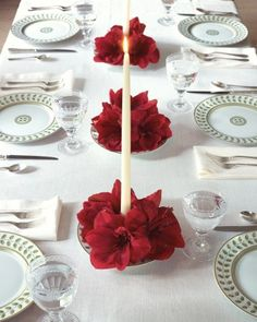 With the help of these candle and flower centerpieces, the whole table will shine. For each one, use candle wax to attach a small floral frog to the center of a shallow bowl. Push a taper into the floral frog to secure. Pour water into the bowl. Clip amaryllis blooms (or other large flowers) from their stems, and arrange them in the bowl around the candle.