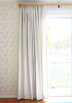 Wooden Header in front of curtains