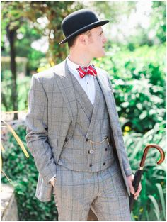 supper dapper groom style complete with bowtie, hat and brolly