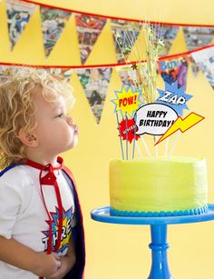 superhero party with free printables at One Charming Party {LOVE the comic book garland!}