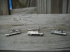 Spooky Hearse Charm Necklace and Earring Set. via Etsy.