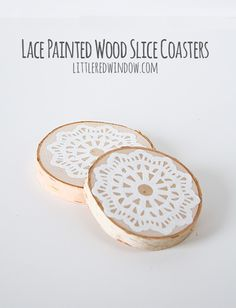We'd happily set a drink on these lace-painted wood slice coasters. #DIY