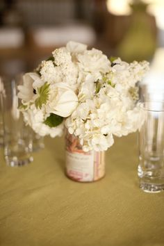 Pretty white centerpieces in vintage cans. Camilla Svensson Burns Couture Floral. Allyson Magda Photography.