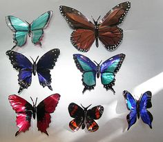 Beautiful butterflies - made from aluminum soda / beer / beverage cans! Great upcycle / recycle / repurpose craft - colored with permanent markers - very good tutorial here - i tried it myself and it's amazing how vibrant the colors really are!