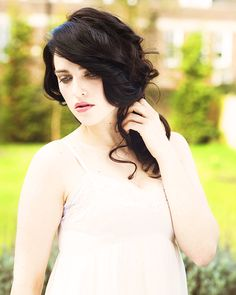 pale skin, blue eyes and black hair <3