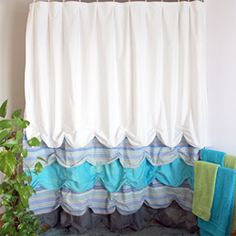 Shower curtain with style is simple and cheap to make. Recycle old bed sheets, and get the new look for your bathroom with this tutorial!