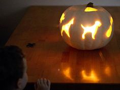 Use cookie cutters to create a high-end look for your jack-o'-lanterns with kid-friendly themes, from planes to stars, flowers and more.