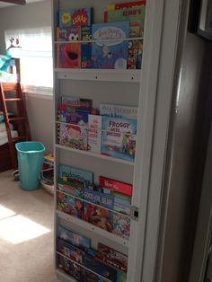 Book shelf for wasted space on the wall! Gets books out for Kids to see to want to read