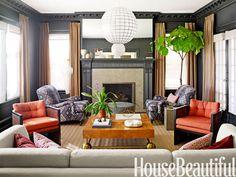 An updated 1920s living room. Design: Christos Prevezanos. Photo: John Coolidge. housebeautiful.com. #livingroom #orange #fireplace