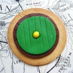 Lots of ideas, suggestions and links to helpful content that you can use if you're having or putting on a Hobbit themed party. Featured here are some Hobbit Door Cookies.