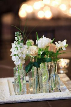 Small vases and a mirror as the center pieces