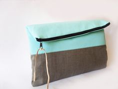 Clutch purse, Light Turquoise/ Aqua color and grey, color block, Fold over. $27.00, via Etsy.