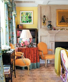 Living Room -  Yellow walls, orange pops with blue and green.  Drapery ties it all together.  Natural fiber rug. by Jeffrey Bilhuber, Greenwich CT