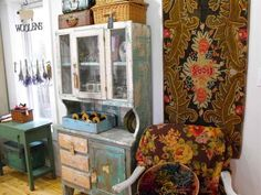 Love this antique hutch and the little table