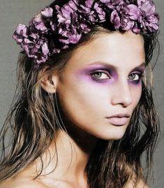 Purple flowers in her hair & matching eye makeup