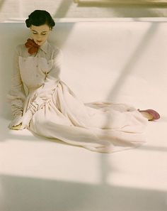 John Rawlings 50s fashion all white with red neck bow