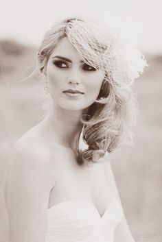 Love the smokey eyes and the bird cage veil