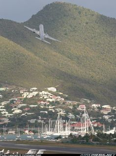 An incredible takeoff from Princess Juliana International. A steep climb angle along with sharp right turn makes this departure exhilarating.  American Airlines Boeing 757-223  Philipsburg / St. Maarten - Princess Juliana (SXM / TNCM) St. Maarten, March 21, 2005