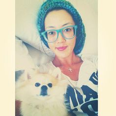 "Golfer Michelle Wie @ themichellewie tweeted this photo of her dog:  ""Sunday pre travel snuggle fest with my baby <3"""