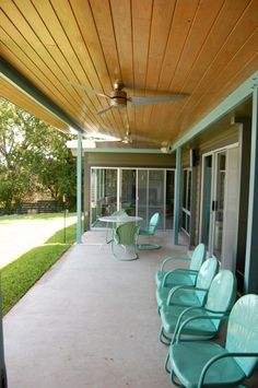 Turquoise chairs on a porch. . .