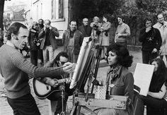 """Diahann Carroll sits for a portrait by French singer Charles Aznavour on the Place Du Tertre in Montmartre, an artist meeting place in Paris on Sept. 13, 1972. They were filming """"Cole Porter in Paris,"""" an NBC special that aired in January 1973. Photo: AP."""