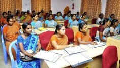 Members of a self help group attending a lecture on the importance of availing micro insurance policies.