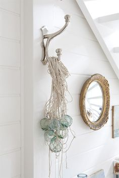 Hamptons Style by Tara Dennis. Hanging fishing floats in a cluster.