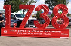 Display made showing the number of lives saved by seat belt since Click It or Ticket started in Utah in 2000. The numbers are wrapped with more than 5,000 feet of seat belt material. Buckle up!