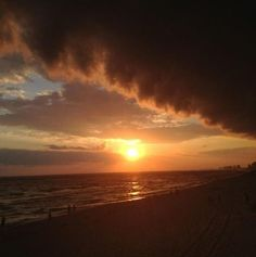 Sunset with clouds full of storms during Hurricane Beryl in Gulf Shores, AL